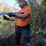 Yaroslav is sharpening machete